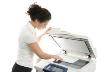 131417-425x281-woman-with-copier